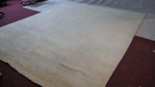 A large 1960's vintage off-white tufted wool carpet. L.340 W.285cm