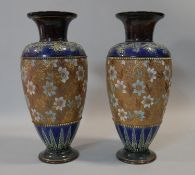 A pair of Doulton and Slaters patent stoneware baluster vases in blue and brown glaze with floral