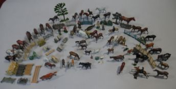An extensive collection of vintage painted lead farmyard and sporting animals and people, around 100