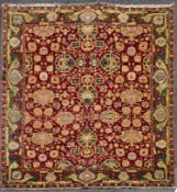 A fine large Agra carpet with all over repeating scrolling palmette and lotus flower decoration on a
