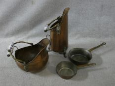 Two matching copper coal scuttles with blue and white ceramic handles along with two vintage