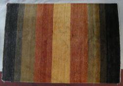 A woollen carpet with polychrome bands. L.250 W.170cm