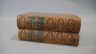 Two 19th century leather bound gilded volumes of Swift's Works, with marbling to the page edges. H.