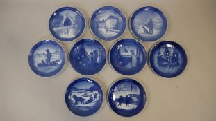 A collection of nine Royal Copenhagen commemorative Christmas plates from the 1970's and 1980's each