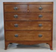 A Regency mahogany chest of drawers with satinwood and ebony stringing and original handles on swept