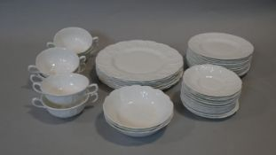 A part dinner service, Wedgwood, Countryware, seven dinner plates, soup bowls, side plates etc,