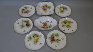 An antique Hadley Roses Royal Worcester hand painted cake set. Including six plates and two