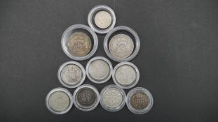 Ten silver coins in capsules. Including 1906 and 19012 silver one shilling coins, seven silver