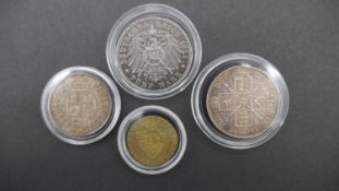 Four antique coins. Including a Great Britain, 1887 Jubilee Head silver Shilling, a German silver