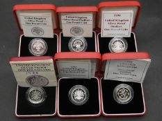 Six Royal Mint silver proof one pound coins. Four silver proof Piedfort one pound coins all in red