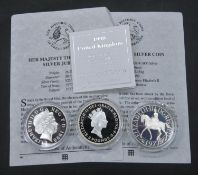Three silver proof coins. Including a 1997 Silver Britannia Proof coin with COA, 1977 Silver Proof
