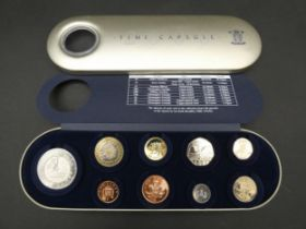 A Great Britain 2000 Royal Mint Time Capsule tin. Containing 9 coins, with COA. Limited edition