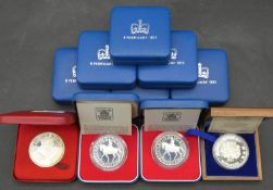 Ten Royal Mint silver proof coins. Including eight cased silver proof 1997 crowns with COA's, a