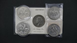 Five silver coins. Including a 1935 silver crown of George V in a presentation wallet, two 1935