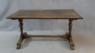 A 19th century country oak style dining table on turned baluster stretchered supports. H.75 L.153