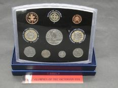 A Royal Mint 2001 United Kingdom 10-Piece proof set Glimpses of the Victorian Era, with COA and blue