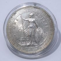 A 1909 Hong Kong silver trading dollar in capsule case. With COA. Weight 28g From a private