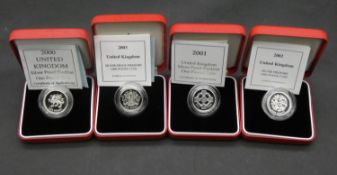 Four one pound silver proof Piedfort pound coins. All in red leather presentation cases with COA'