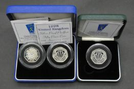 Three Royal Mint silver proof 50p coins. Including a cased set of two silver proof piedfort 50 pence