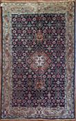 A Persian Tabriz rug with stepped central medallion on a midnight field with all over floral