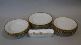 A collection of porcelain plates. Including a set of six of three different sizes of plates by