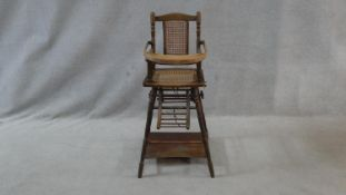 A Victorian beech framed metamorphic child's high chair with fold down tray converting to play