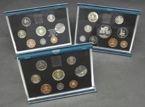 A collection of three sets of proof coins. Including a 1996 Royal Mint Proof et including the