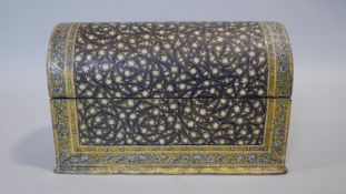 An Indian papier-mâché stationery box with domed lid and all over finely painted floral