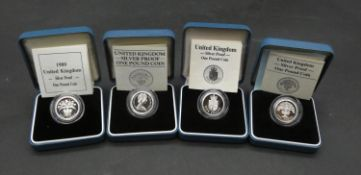 Four Royal Mint cased silver proof pound coins. Each in pale blue presentation case with COA.