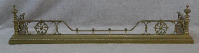 A 19th century brass fire fender with reeded shaped finials on stepped base. H.29 L.134 W.37cm