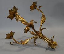 A gilt metal five branch candelabra with naturalistic flower and leaf arms L.48cm