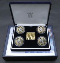 A boxed GB Royal Mint 2002 Commonwealth Games Manchester four £2 silver proof commemorative coin set