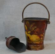 A metal coal bucket and scoop with brass handles and lacquered collage decoration. H.65cm