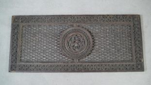 A 19th century heavy cast iron grille with intricate foliate central roundel and border. H.121 W.