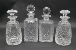 A pair of mallett form cut crystal decanters with stoppers and two other decanters. H.26.5cm (