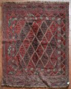 An Afghan Sumak rug with repeating diamond pattern across the field within geometric borders. L.