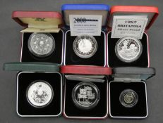 Six Royal Mint silver proof coins. Including a cased 1999 Britannia one ounce fine silver proof
