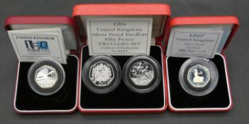 Four Royal Mint piedfort silver proof 50 pence coins. Including a UK 150 years Public Library silver