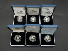Six Royal Mint one pound silver proof coins. All in pale blue presentation cases, including 1999,