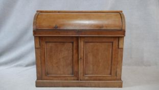A 19th century mahogany cylinder top bureau with fitted interior and pull out leather inset