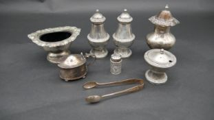 A miscellaneous collection of silver plated table items, salt, mustard pot, shakers etc. H.12cm