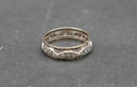 An antique white metal and yellow metal eternity band set with hand cut white stones. With shaped