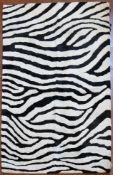 A modern Zebra skin patterned woollen rug. L.180xW.120cm