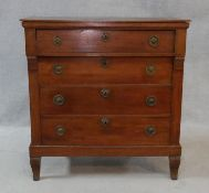 A 19th century French Provincial oak Empire style chest with frieze drawer above a further three