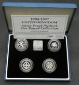 A Royal Mint One Pound Silver Proof Piedfort one pound coin set 1994 - 1997. In pale blue leather