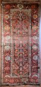 An antique Persian Malayer rug with central lozenge medallion within a broad naturalistic foliate