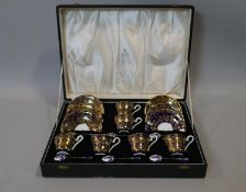 A six person Aynsley cobalt and gold floral design coffee set with six silver and guilloche Royal