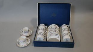 A Royal Worcester June Garland, six person coffee set, boxed with two spare cups and saucers (one