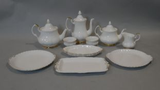 A Royal Albert fine bone china Val D'Or pattern part tea and coffee set. Including large and small