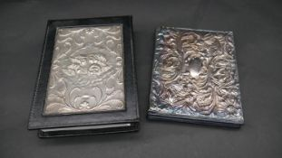 Two leather silver fronted note books, one with repousse floral decoration hallmarked: JBLd for John
